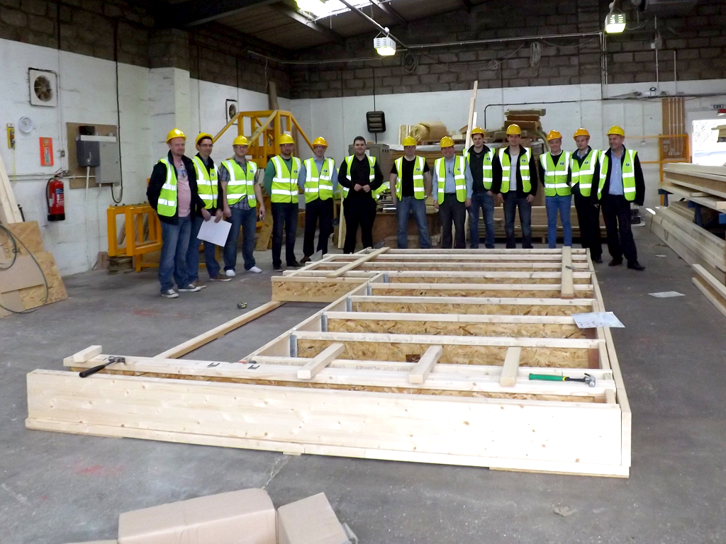 Delegates building a floor at James Jones Timber Systems Division